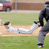 Don Knight   The Herald Bulletin<br /> Daleville short stop Max Stecher tags Monroe Central's Jordan Willen out as he attempts to steal second base on Wednesday.