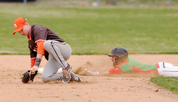 Don Knight   The Herald Bulletin<br /> Anderson's Brayden Waymire steals second base as the Indians hosted Hamilton Heights on Thursday.