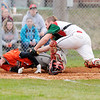 Don Knight | The Herald Bulletin<br /> Anderson catcher Cameron McGlothlin tags Hamilton Heights' Issiac Hickok out at home as the Indians hosted the Huskies on Friday.