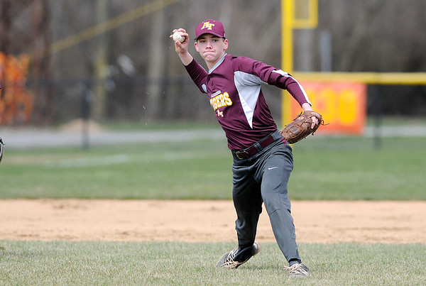 Don Knight | The Herald Bulletin<br /> Alexandria's Matthew Etherington throws to first as the Tigers hosted the Clinton Central Bulldogs for a double header on Saturday.
