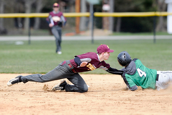 Don Knight | The Herald Bulletin<br /> Alexandria's Ryan Luzader tags Clinton Central Spencer Smith out at second base as the Tigers hosted the Bulldogs for a double header on Saturday.