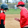John P. Cleary | The Herald Bulletin  <br /> Liberty Christian's Alayna Thomas gets instructions from head coach Dan Russell at third base.