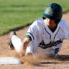 Don Knight | The Herald Bulletin<br /> Pendleton Heights' Walker Stull dives back to first as the Arabians hosted the Alexandria Tigers in the first round of the Nick Muller Memorial Baseball Tournament on Tuesday.