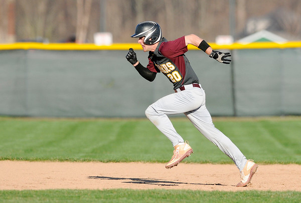Don Knight | The Herald Bulletin<br /> Alexandria's Brandon Patz runs to second as the Tigers faced the Pendleton Heights Arabians in the first round of the Nick Muller Memorial Baseball Tournament on Tuesday.