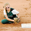 Don Knight | The Herald Bulletin<br /> Pendleton Heights' Jade Mollenkopf reaches for first base to force a runner out after fielding a ball as the Arabians hosted the Greenfield Cougars on Tuesday.
