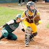 Don Knight | The Herald Bulletin<br /> Pendleton Heights' Delaney Long beats the throw to Greenfield catcher Erika Knapp on a single by Olivia Conner on Tuesday.