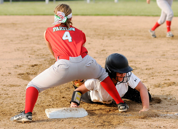 Don Knight | The Herald Bulletin<br /> Lapel's Addie Bailey dives back to first to avoid the tag from Anderson's Ally Partlow as the Bulldogs hosted the Indians on Wednesday.