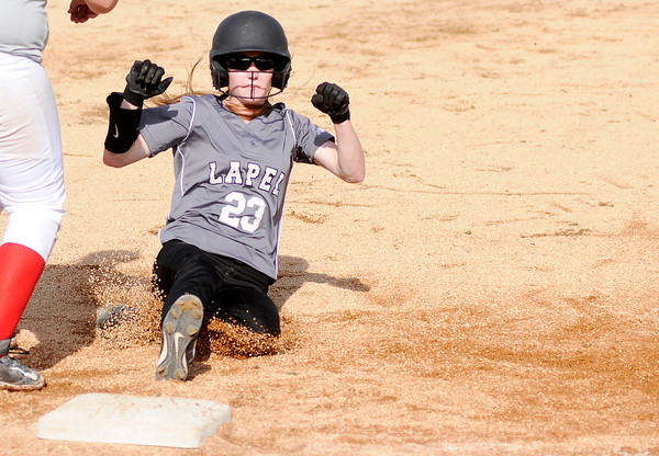 Don Knight | The Herald Bulletin<br /> Lapel's Kylie Rich slides safely into third as the Bulldogs faced the Tribe in Anderson on Wednesday.