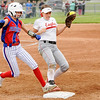 Don Knight | The Herald Bulletin<br /> Frankton's Sarah Stanley steps on first base just in time to force Elwood's Aisah McGuire out as the Panthers hosted the Eagles on Thursday.