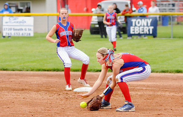 Don Knight | The Herald Bulletin<br /> Elwood's Gabby Leavell fields the ball as the Panthers hosted the Frankton Eagles on Thursday.