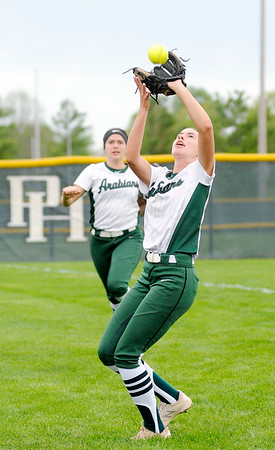 Don Knight   The Herald Bulletin<br /> Pendleton Heights' Kylie Davis catches a foul ball as the Arabians hosted New Palestine on Wednesday.