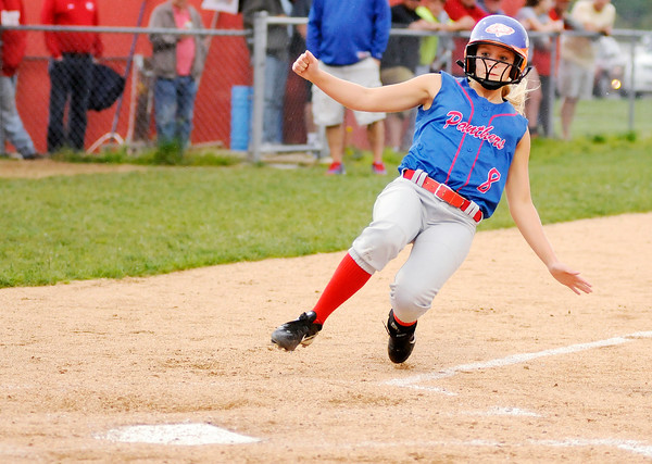 Don Knight | The Herald Bulletin<br /> Elwood's Holly Sallee slides into home on a wild pitch as Frankton hosted Elwood on Thursday.