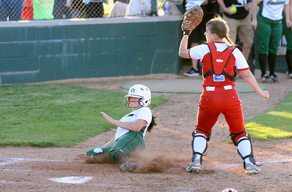 Don Knight | The Herald Bulletin<br /> Pendleton Heights' Chloe Closser slides into home on  a double by Lauren Landes to give the Arabians a 5-4 lead over Martinsville on Friday.