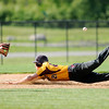 Don Knight | The Herald Bulletin<br /> Alexandria's Miller Abernathy beats the throw to Anderson's Dylan Barron at third base as the Tigers hosted the Indians on Friday.
