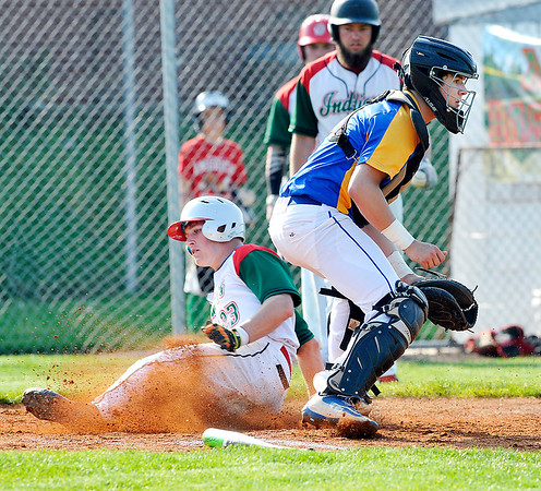John P. Cleary   The Herald Bulletin<br /> Anderson's Jacob Morris slides across home plate ahead of the throw to score one of the three runs in the first inning.