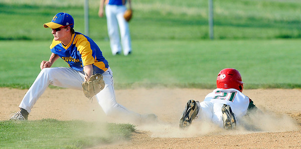 John P. Cleary | The Herald Bulletin<br /> Anderson's Mercklin DeWitt slides into second base ahead of the throw for a steal in the first inning.