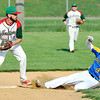 John P. Cleary | The Herald Bulletin<br /> Anderson's Brayden Waymire turns to throw to first as Greenfield-Central's Dawson Davis slides into second in an attempted double play in the second inning. The running at first was called safe on the play.