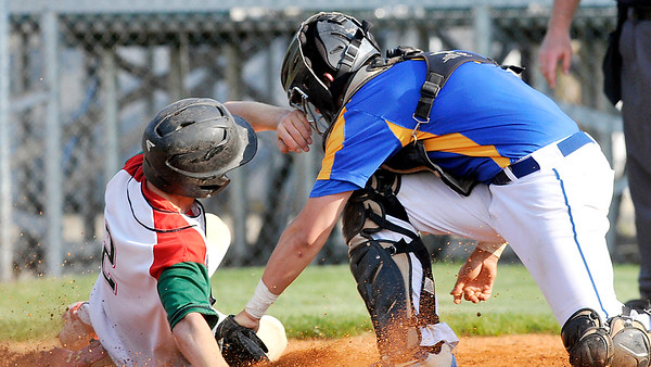 John P. Cleary   The Herald Bulletin<br /> Anderson's Brayden Waymire beats the tag as he slides into home as Greenfield-Central's catcher, Braxton Turner, puts on a late tag in the third inning.