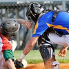 John P. Cleary | The Herald Bulletin<br /> Anderson's Brayden Waymire beats the tag as he slides into home as Greenfield-Central's catcher, Braxton Turner, puts on a late tag in the third inning.