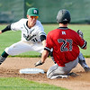 John P. Cleary |  The Herald Bulletin<br /> Richmond vs Pendleton Heights in boys baseball.  Pendleton's shortstop Wyatt Douglas puts the tag on Richmond's Austin Turner as he slides into second base on an attempted steal in the second inning. Turner was out on the play.