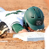 John P. Cleary |  The Herald Bulletin<br /> Pendleton's Brandon Helpling gets a face-full of dirt as he dives back into firstbase on an attempted pickoff play against Richmond.