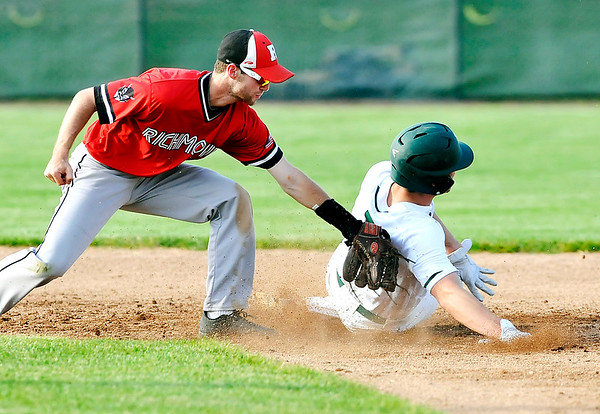 John P. Cleary |  The Herald Bulletin<br /> Richmond's Austin Turner just barely catches the back of Pendleton's Corbin Cox as he attempted to steal second base after the ball got past the catcher in the third inning.