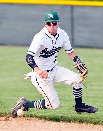 John P. Cleary |  The Herald Bulletin<br /> Pendleton's second baseman Phillip Lawson runs to his left to grab the ball in the hole to throw the runner out at first.