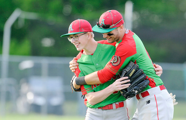 Don Knight | The Herald Bulletin<br /> Anderson's Cameron Pratt, right, celebrates Caleb Richardson's game against the Lapel Bulldogs on Wednesday. Richardson completed 7 innings on the mound throwing only 54 pitches in the Indians 2-1 win.