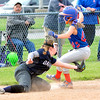 John P. Cleary | The Herald Bulletin<br /> Elwood's Jilliann Reese reaches third base ahead of the tag by Oak Hill's Maria Buckler after a throwing error in the third inning.