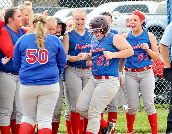 John P. Cleary | The Herald Bulletin<br /> Elwood's Haley Jetty is greeted by her teammates after hitting a 2-run homer in the 3rd inning against Oak Hill.