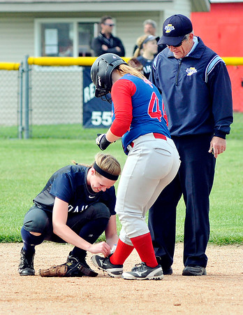 John P. Cleary | The Herald Bulletin<br /> Oak Hill's infielder Toni Lautzenheiser ties Elwood base runner Shantel Blackford's shoe at 2nd base after Blackford asked to time from the umpire.