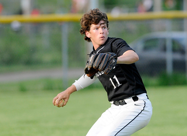 Don Knight | The Herald Bulletin<br /> Lapel's Satchell Wilson checks the base runners after catching a fly ball as the Lapel Bulldogs faced the Anderson Indians at Memorial Field on Wednesday.