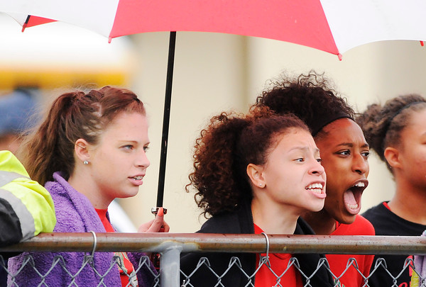 Don Knight | The Herald Bulletin<br /> From left, Cydney Slavon, Amaani Welch and Ariahna Hudson cheer for their teammate Staisha Hamilton during the 100 meter dash prelims at the girls track sectional at Pendleton Heights on Tuesday.