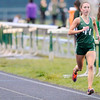 Don Knight | The Herald Bulletin<br /> Pendleton Heights Alex Buck demolishes her own sectional 3200 meter run record during the girls track sectional at Pendleton Heights on Tuesday.