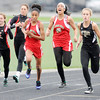 Don Knight | The Herald Bulletin<br /> Anderson High School's Ariahna Hudson takes the baton from Pearson Newsom in the 4 by 100 relay during the girls track sectional at Pendleton Heights on Tuesday. The Indians finished third to advance to the regional.