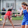 Don Knight | The Herald Bulletin<br /> At No. 1 singles, Elwood's Brooke Creamer returns a volley to Anderson's Lex Heruth in the No. 1 singles match during the first round of the tennis sectional at Highland Middle School on Wednesday. Creamer won in three sets,  6-3, 4-6, 6-3.