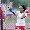 Don Knight | The Herald Bulletin<br /> Anderson's Lauryn Hill returns a volley to Elwood's Bree Lewellyn in the No. 2 singles match during the first round of the tennis sectional at Highland Middle School on Wednesday. Hill won in three sets, 4-6, 6-4, 6-4.