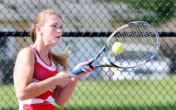 John P. Cleary |  The Herald Bulletin<br /> Frankton's #2 singles player Sherrie Riser returns a shot during her match against Alexandria in sectional play Thursday.