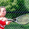 John P. Cleary |  The Herald Bulletin<br /> Frankton's #1 singles player Emma Noble returns a shot during her match against Alexandria in sectional play Thursday.
