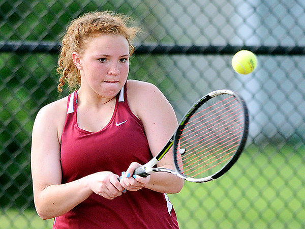 John P. Cleary |  The Herald Bulletin<br /> Alexandria's #3 singles player Lindsie Chaplin returns a shot during her match against Frankton in sectional play Thursday.