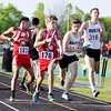 John P. Cleary | The Herald Bulletin<br /> Anderson's Aaron Ditsworth, #176, gets a step on Lawrence North's runner Joshua Hoeft during the third leg baton exchange in the 4x800 meter relay.<br /> Anderson went on to win the race.