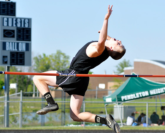 John P. Cleary | The Herald Bulletin<br /> Daleville's Dylan Hicks clears the bar during the high jump competition at the Mt. Vernon track sectional.  Hicks finished 3rd.