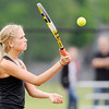 Don Knight | The Herald Bulletin<br /> Lapel Senior Peighton Dobbins returns a volley to Alexandria's Colleen Matthew in the No. 2 singles match during the sectional at Highland Middle School on Friday. Dobbins won her match and Lapel won the sectional.