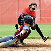 John P. Cleary | The Herald Bulletin <br /> Wapahani's Alyvia Smith tries to put the tag on Alexandria's Madisyn Standridge as she slides into second base safely in the third inning.