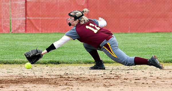 John P. Cleary | The Herald Bulletin <br /> Alexandria infielder Kirsten VanHorn stretches out to try to snag this hard hit grounder.