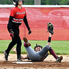 John P. Cleary | The Herald Bulletin <br /> Alexandria's Madisyn Standridge holds up the ball to show the ump after she collided with Wapahani's Chrissa Clairday at second base to get her out.