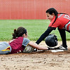 John P. Cleary | The Herald Bulletin <br /> Alexandria's Madisyn Standridge slides back into second base as her helmet flies off as Wapahani's Lala Lee tags her out after Standridge got caught in a run-down in the third inning.