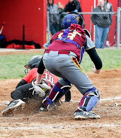 John P. Cleary   The Herald Bulletin <br /> Alexandria catcher Mackenzie Swango puts the tag on Wapahani's Emma Schuck as she tries to score in the fourth inning to get her out.