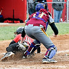 John P. Cleary | The Herald Bulletin <br /> Alexandria catcher Mackenzie Swango puts the tag on Wapahani's Emma Schuck as she tries to score in the fourth inning to get her out.