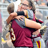 John P. Cleary | The Herald Bulletin<br /> Alexandria's Mackenzie McCarty gives teammate Alliyah Standridge a big hug after she hit a grand slam home run in the second inning to give Alexanria a 5-0 lead over Monroe Central.